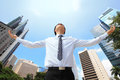 Carefree business man arms up Royalty Free Stock Photo