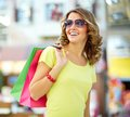Carefree buyer cool shopping girl enjoying a weekend at mall Royalty Free Stock Image