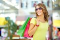 Carefree buyer cool shopping girl enjoying a weekend at mall Royalty Free Stock Images