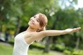 Carefree and free woman cheering in the park girl raising her arms up smiling happy asian beauty Stock Photo