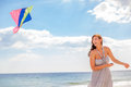 Carefree happy female laughin on using kite Stock Photography