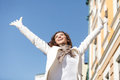 Carefree and happy low angle view of happy young women standing woman with her hands raised up Royalty Free Stock Photography