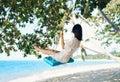 Carefree happy woman on swing on beautiful paradises beach Royalty Free Stock Photo