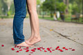 Carefree lovers bare feet of among rose petals Royalty Free Stock Photos