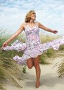 Carefree middle aged woman dancing outdoors portrait of a Royalty Free Stock Image