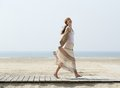 Carefree middle aged woman walking barefoot Royalty Free Stock Photo