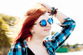 Carefree red hair young woman beautiful in sunglasses Stock Photography