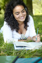 Carefree Student Revising And Listening To Music In Park Royalty Free Stock Photo