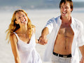 Carefree walking beach couple Royalty Free Stock Photo