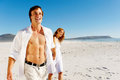 Carefree walking beach couple Royalty Free Stock Images