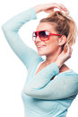 Carefree woman playing with her blond hair attractive young wearing sunglasses isolated on white Royalty Free Stock Image