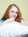 Carefree woman with red hair on a pillow beautiful young long relaxing Stock Images