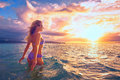 Carefree woman in the sunset on the beach beatiful sunset young vacation vitality healthy living concept Royalty Free Stock Images