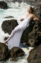 Carefree woman in white dress in the ocean Royalty Free Stock Photo