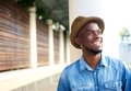 Carefree young african american man laughing close up portrait of a cheerful Royalty Free Stock Photography