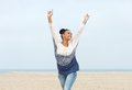Carefree young woman with arms outstretched walking on the beach close up portrait of a Royalty Free Stock Images