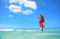 Carefree young woman enjoying clear water of the carribean sea exotic Royalty Free Stock Photos