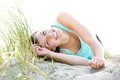 Carefree young woman lying on beach close up portrait of a the Stock Images