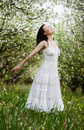 Carefree young woman in park Stock Photo