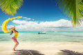 Carefree young woman relaxing on tropical beach a Royalty Free Stock Photography