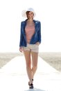 Carefree young woman walking by beach portrait of a Stock Photo