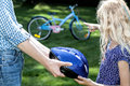Careful parent protecting his child from a bike accident Royalty Free Stock Images