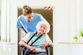 Caregiver with senior patient in wheel chair Royalty Free Stock Photo