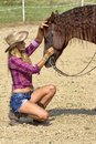 Caressing the horse sexy cowgirl beautiful brown Stock Photography