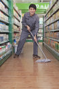 Caretaker cleaning floor in supermarket Royalty Free Stock Images