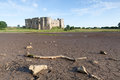 Carew castle old ruins pembrokeshire wales uk medieval facing a drained pond Stock Photos