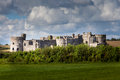 Carew castle pembrokeshire wales in is an ancient building and part of the line of castles separating Stock Photo