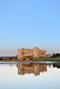 Carew castle in wales at sunset in winter months clear blue sky Stock Photography