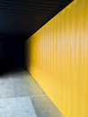 Cargo container deep to the dark with yellow wall