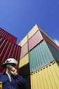 Cargo containers and dock worker Royalty Free Stock Images