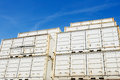 Cargo containers on dockside white transport with blue sky Stock Photos
