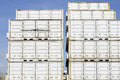 Cargo containers on dockside white transport with blue sky Royalty Free Stock Photo