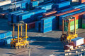 Cargo containers loading and unloading in logistics terminal Royalty Free Stock Images