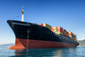 Cargo containers ship container anchored in harbor Stock Image