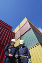 Cargo containers and workers Stock Images