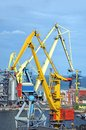 Cargo crane and grain dryer in port odessa ukraine Stock Photo