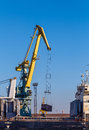 Cargo crane lifting container Royalty Free Stock Photo