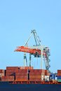 Cargo crane and ship container stack under bridge Stock Images