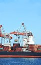 Cargo crane and ship container stack under bridge Stock Image