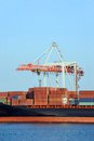 Cargo crane and ship container stack under bridge Stock Photography