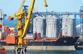 Cargo crane, ship and grain dryer Royalty Free Stock Photos