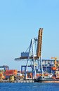 Cargo crane and ship port container over blue sky background Royalty Free Stock Photography