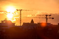 Cargo crane sunset over new buildings and cranes Royalty Free Stock Photo