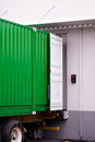 Cargo green container at dock warehouse under loading unloading Royalty Free Stock Photo