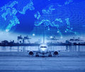 Cargo plane parking in airport runways and shipping port behind Royalty Free Stock Photo