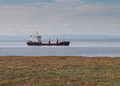 Cargo ship in bristol channel england landscape view of the and severn estuary between and wales with a freighter vessel going Royalty Free Stock Photography
